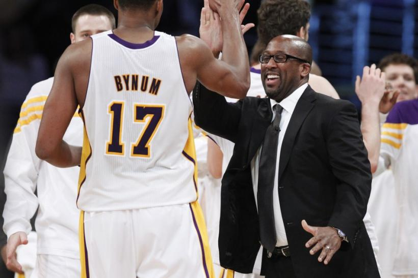 Mike Brown high-fives Andrew Bynum as he comes off the court. Their relationship has been rocky so far this season.
