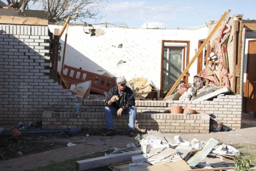 Norman Nelson, of Woodward, Oklahoma, takes a break from cleaning up the home of his mother, Wilma Nelson, 87, after a tornado