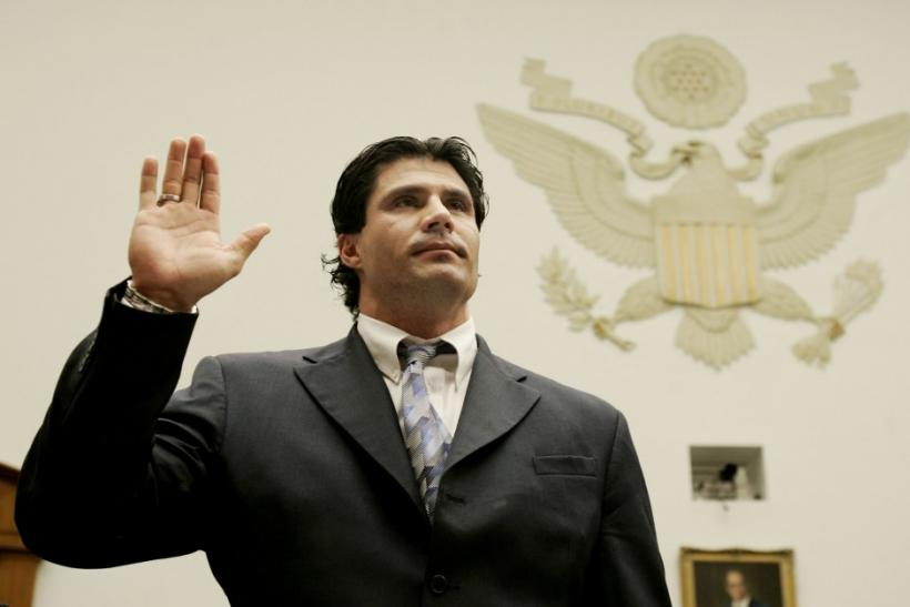 Former major league baseball player Jose Canseco is sworn in before House baseball steroids hearing.