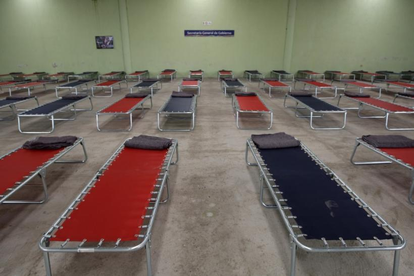 Folding beds are prepared at a permanent shelter in San Nicolas de los Ranchos
