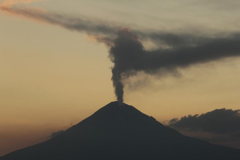 The Popocatepetl volcano spews a cloud of ash and steam high into the air as seen from Puebla