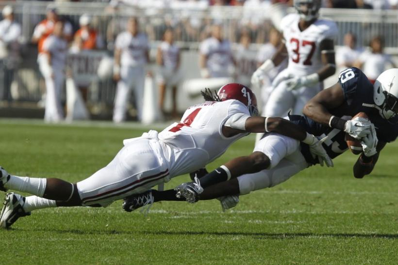 Alabama safety Mark Barron makes a tackle against Penn State last season.