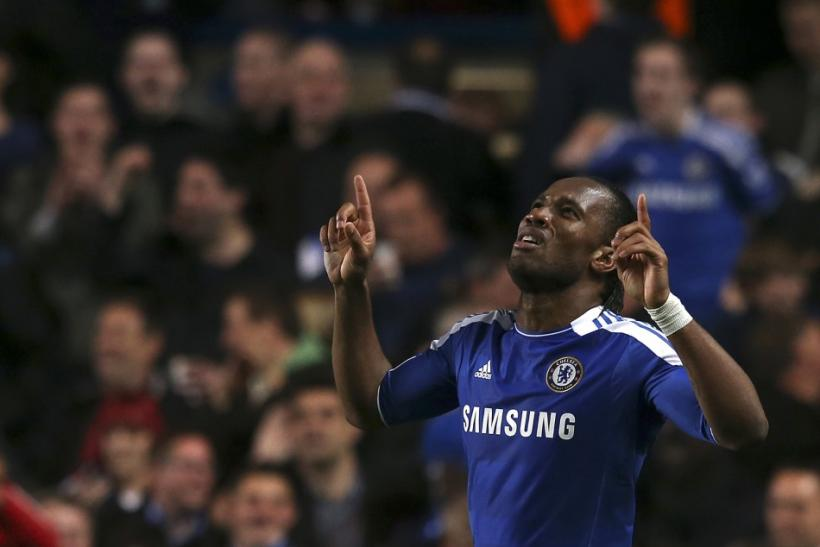 Didier Drogba celebrates after scoring the only goal of the game.