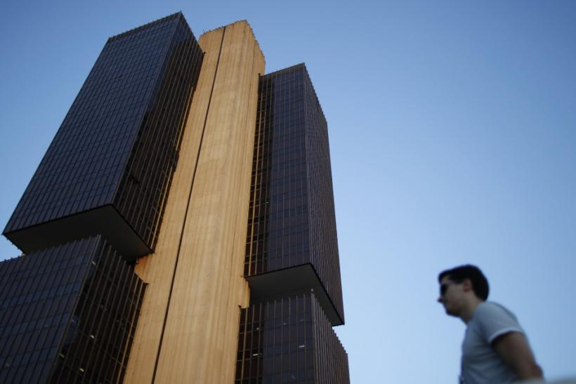 A man stands near the headquarters of the central bank in Brasilia September 22, 2011.