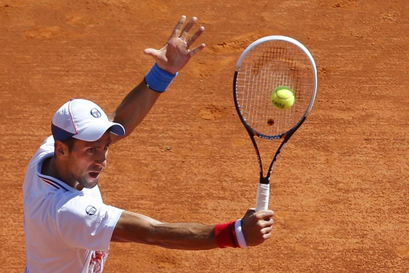 Djokovic returns the ball to Haase during the quarter-final of the Monte Carlo Masters in Monaco