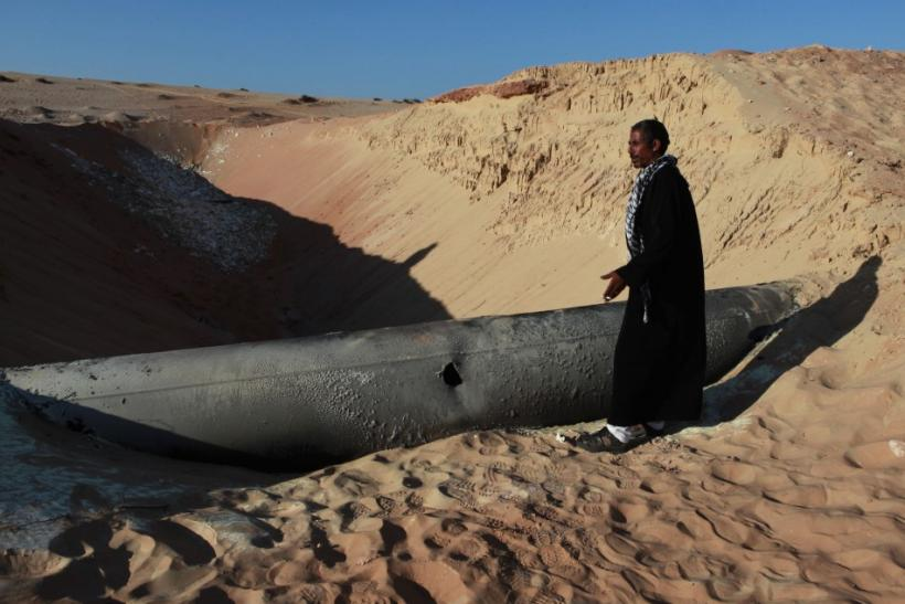 A Bedouin man looks at a gas pipeline in North Sinai