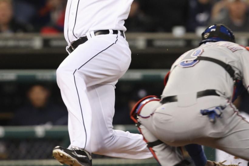 Tigers outfielder Delmon Young will miss some time after a hate-crime arrest Friday morning.