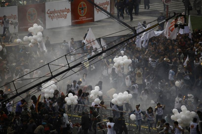 A view shows the crowd right after the explosion of gas-filled balloons during a campaign rally in the central Republic Square in Yerevan, May 4, 2012.
