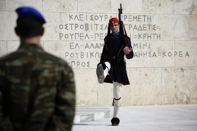 A presidential guard (R) is seen outside the Greek Parliament in Athens May 5, 2012.