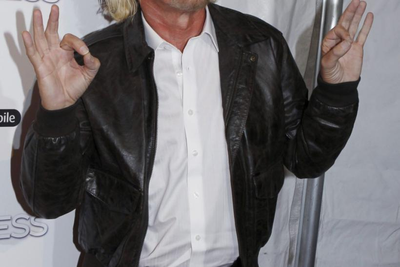 "Sir Richard Branson arrives for the world premiere of ""Limitless"" in New York March 8, 2011."