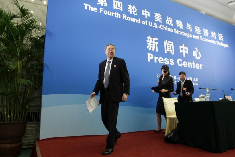 Zhou Xiaochuan, left, China's central bank governor, leaves after a news conference as a part of the U.S.-China Strategic and Economic Dialogue at the Diaoyutai State Guesthouse in Beijing, May 3, 2012.