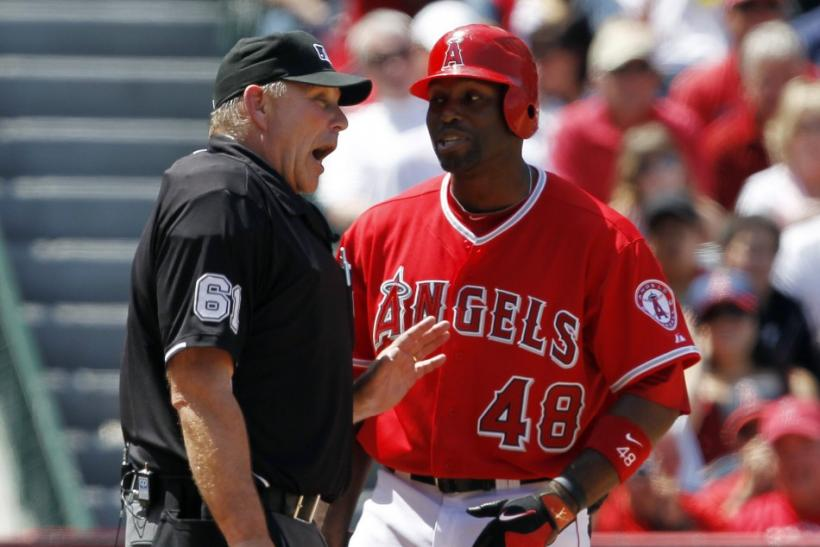 Bob Davidson argues with Torii Hunter after a called strike 3.