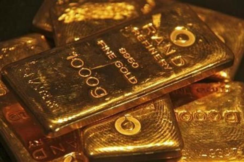 Gold climbs above $1,620 an ounce as euro holds ground
