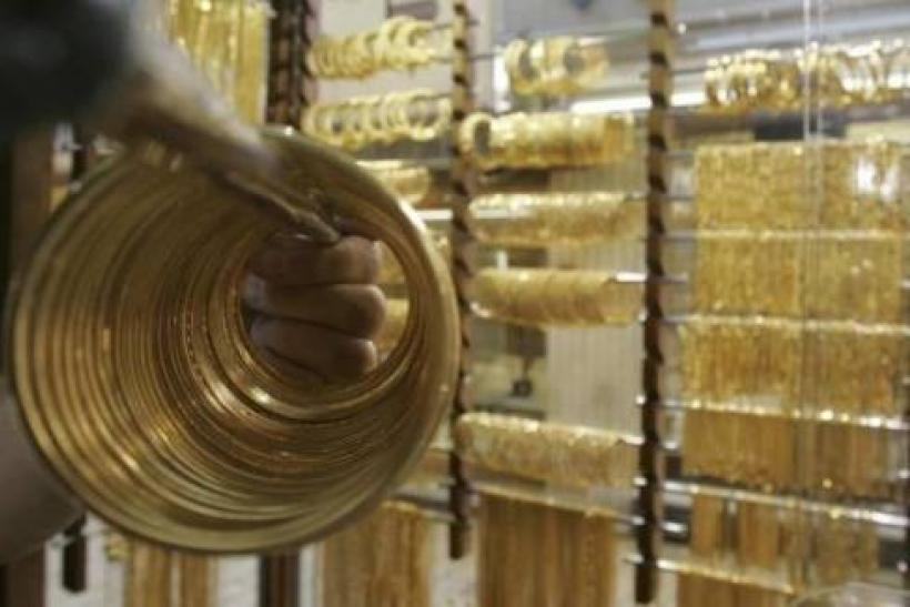 Gold down before Fed meets, euro worries support