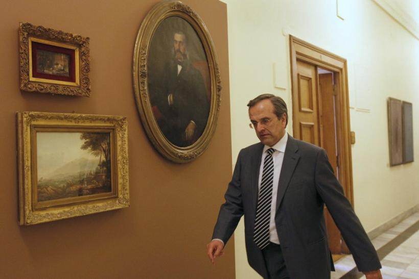 Conservative leader Samaras arrives at parliament for a meeting in Athens