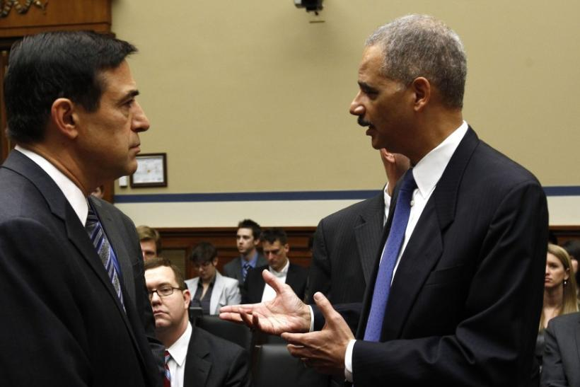 Congressman Darrell Issa, at left, and Attorney General Eric Holder, at right.