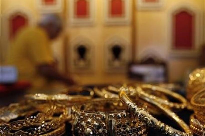 Gold Draws Strength From Dollar Decline