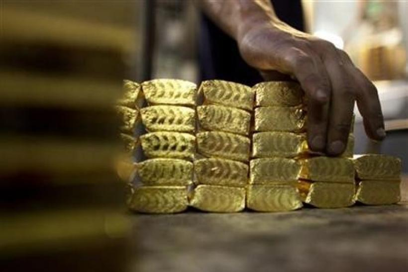 Gold Falls 1 Percent After Fed Gives No Hint of Stimulus