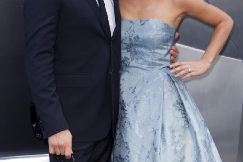"Cast member Tom Hardy and his fiancee attend the world premiere of the movie ""The Dark Knight Rises"" in New York"