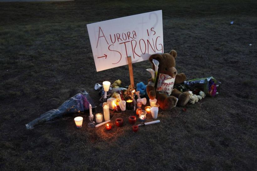 A sign is seen outside a vigil for victims behind the theater where a gunman opened fire in Aurora, Colorado