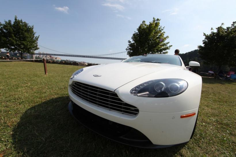 The 2012 Aston Martin V8 Vantage looks sublime parked on the grass.