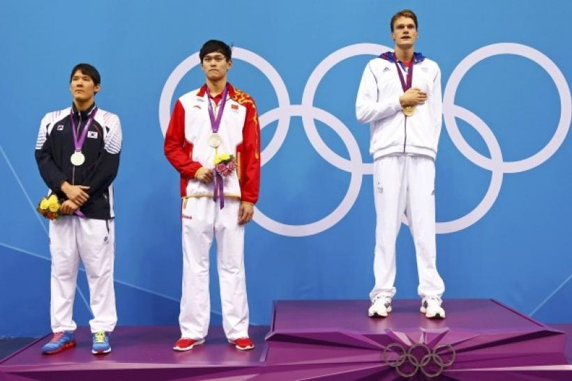 Gold medallist Yannick Agnel of France poses with silver medallists Park Tae-hwan (L) of South Korea and Sun Yang (R) of China during the men's 200m freestyle victory ceremory at the London 2012 Olympic Games at the Aquatics Centre
