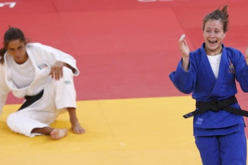 Marti Malloy of U.S. celebrates after defeating Italy's Giulia Quintavalle in women's -57kg bronze medal A judo match at London 2012 Olympic Games