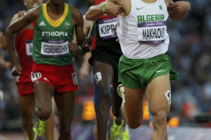 Algeria's Taoufik Makhloufi, Kenya's Asbel Kiprop and Ethiopia's Mekonnen Gebremedhin compete in the men's 1500m semi-final during the London 2012 Olympic Games at the Olympic Stadium