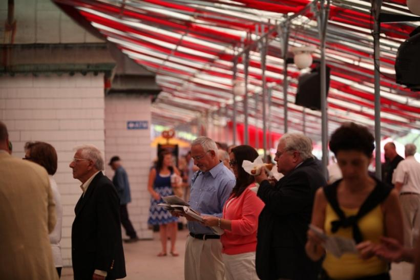 A man considers things closely in the grandstand at the Saratoga Race Course.