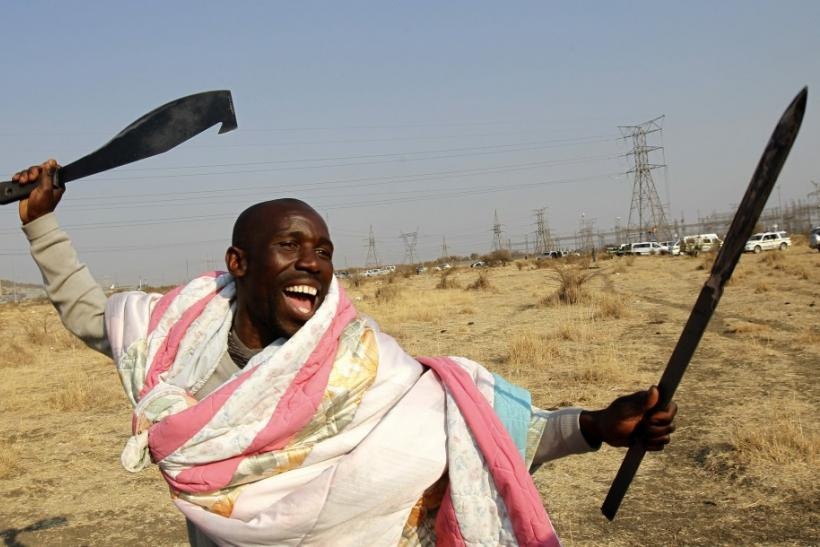 A protester striking at a platinum mine in South Africa Thursday. Many in the crowd were armed.