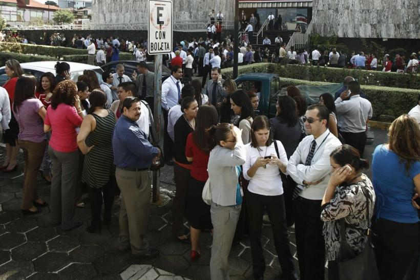 People gather in front of the Supreme Court after being evacuated from their buildings following an earthquake in San Jose