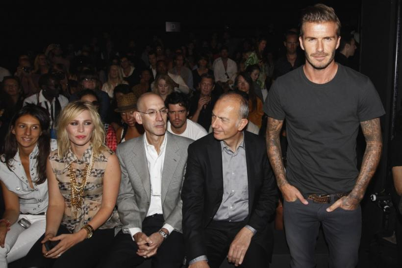 Soccer star David Beckham (R) stands in front of singer Natasha Bedingfield (2nd L) and Adidas executive Erich Stamminger (2nd R) before a presentation of the Y-3 Spring/Summer 2013 collection during a walk through at New York Fashion Week September 9, 20