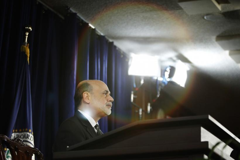 is fed chairman bernanke doing a Bernanke defends fed, promises more stimulus the central banker points the finger at overreacting markets and a do-nothing congress.