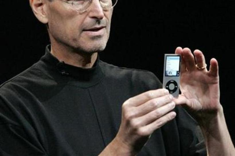 "Apple Inc CEO Steve Jobs displays a redesigned iPod Nano at Apple's ""Let's Rock"" media event in San Francisco"