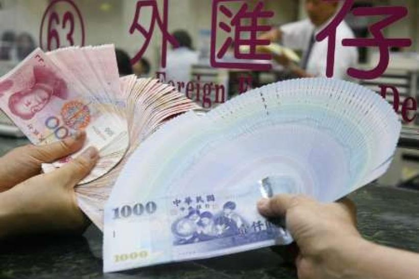 China vows to increase yuan flexibility, warns of fund inflows