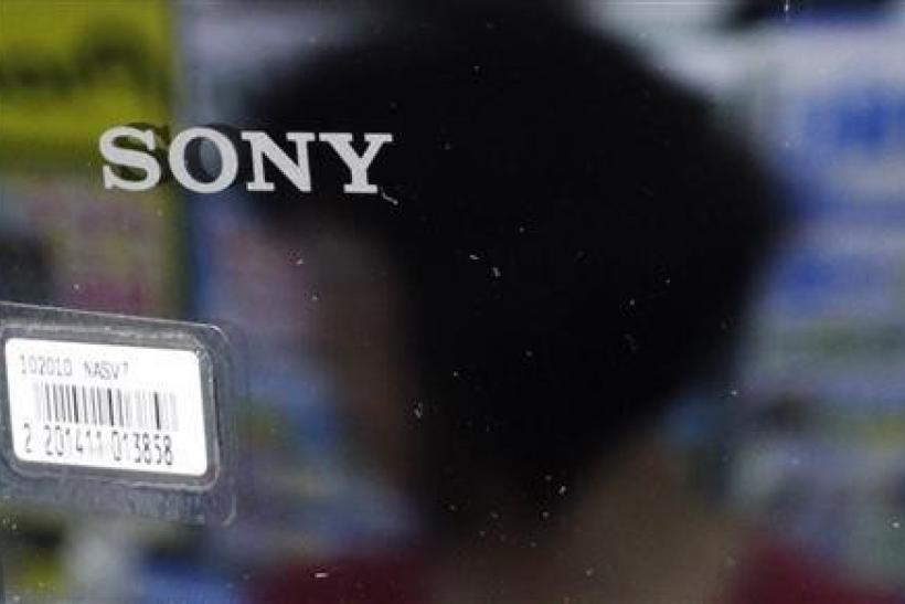 A woman is reflected on a Sony product at an electronics store in Tokyo