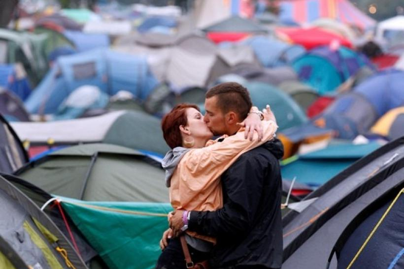 A couple embrace on the third day of the Glastonbury Festival in Somerset