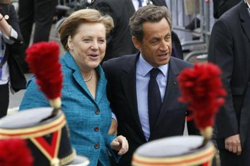German Chancellor Angela Merkel is welcomed by French President Nicolas Sarkozy gesture to G8 Summit in France