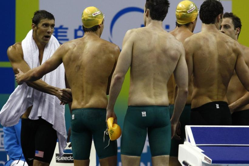 Phelps of the U.S. congratulates members of Australia's team for winning the men's 4x100m freestyle relay final at the 14th FINA World Championships in Shanghai