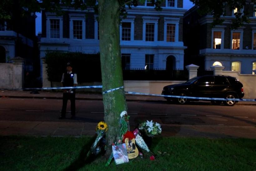 Flowers and notes are seen outside the home of Amy Winehouse in London