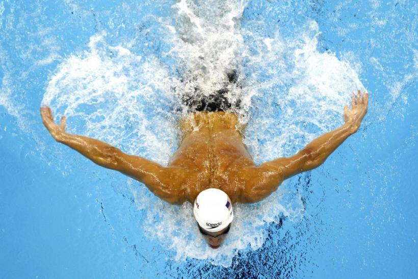 Phelps of the U.S. competes during the men's 200m butterfly heats at the 14th FINA World Championships in Shanghai