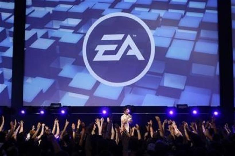 Visitors attend a show by Electronic Arts (EA) at the Gamescom 2009 fair in Cologne