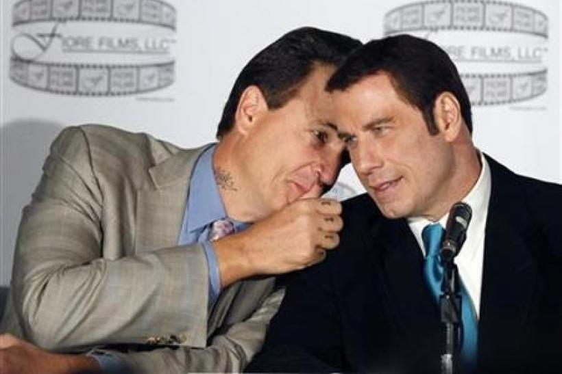 Director Nick Cassavetes (L) talks with actor John Travolta during a news conference to promote the film ''Gotti:Three Generations'' in New York