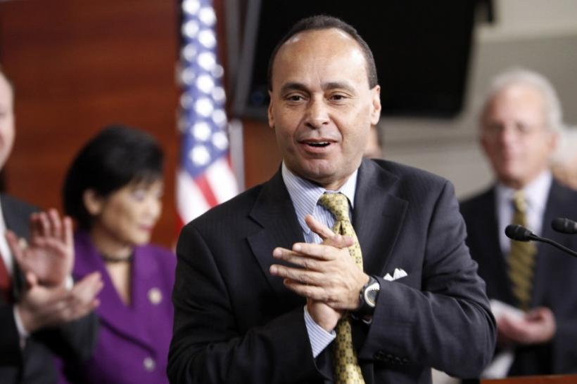 "US Representative Luis Gutierrez applauds at a news conference to celebrate the passage of the ""Dream Act"" in the House of Representatives in Washington"