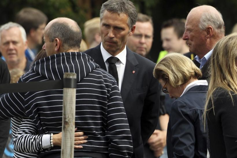 Norwegian King Harald, Queen Sonja and Prime Minister Jens Stoltenberg comfort survivors and family members at a hotel in Sundvollen, northwest of Oslo