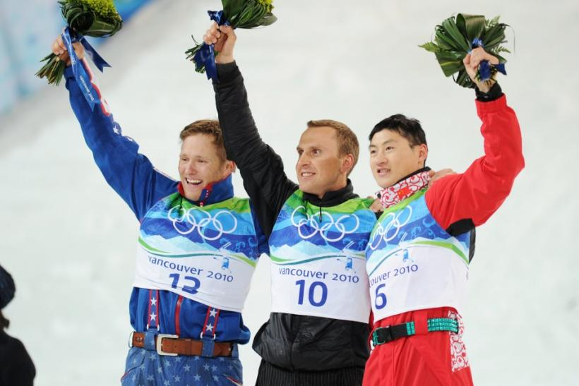 Medalists celebrate on the podium after the men's aerials freestyle skiing final at the Vancouver 2010 Winter Olympics
