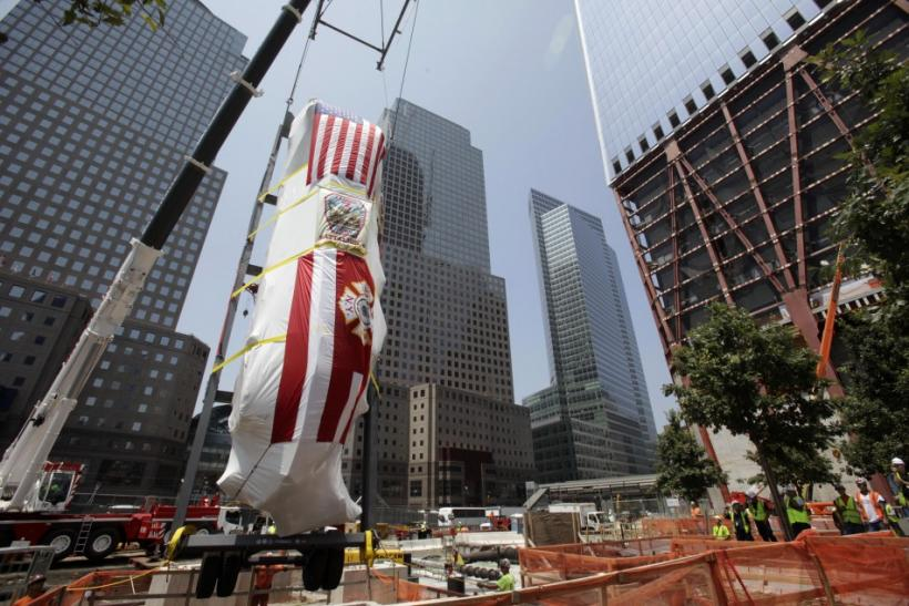A Fire Department of New York Ladder Company 3 fire truck, which was partially destroyed in the September 11, 2001 attacks, is lowered into an opening in the World Trade Center site in New York
