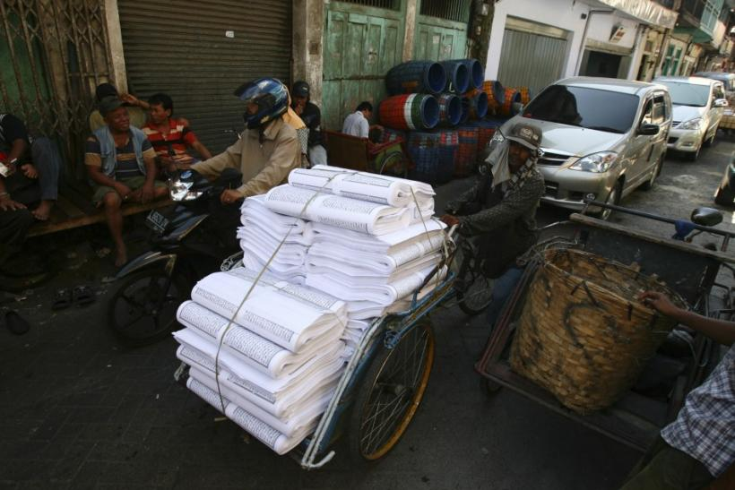 Printing paper for the Koran is transported near Sunan Ampel mosque in Surabaya, Indonesia East Java province