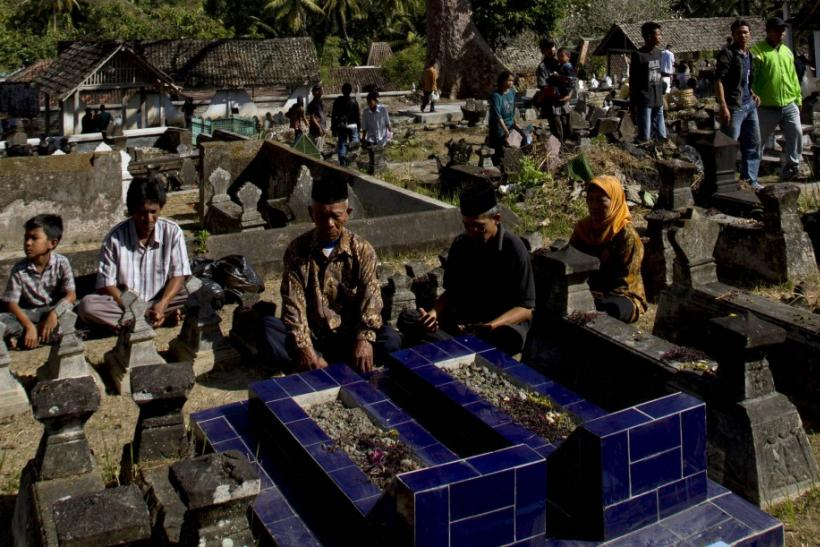 Indonesian Muslims pray at the graves of their relatives in Bantul in central Java