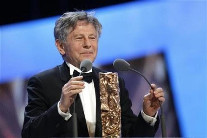 Director Roman Polanski reacts after winning the Best Director award